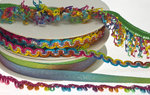 Elastisch franjeband met multicolor mini kwastjes regenboog ca. 30 mm (ca. 10 meter)
