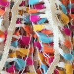 Band met kwastjes creme-geel-oranje-fuchsia-blauw 50 mm (ca. 10 meter)