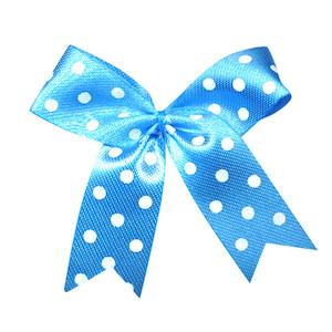 Satijnen strik blauw met witte stip 40x45 mm (ca. 100 stuks)