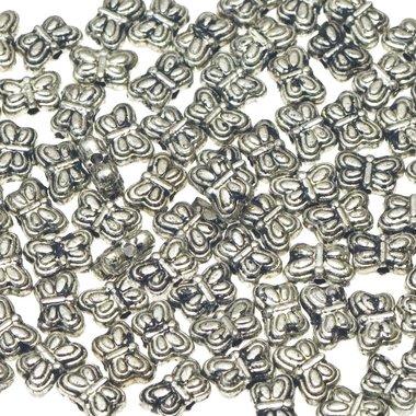 Kralen vlinderje zilverkleurig klein ca. 9x6 mm (ca. 50 stuks)